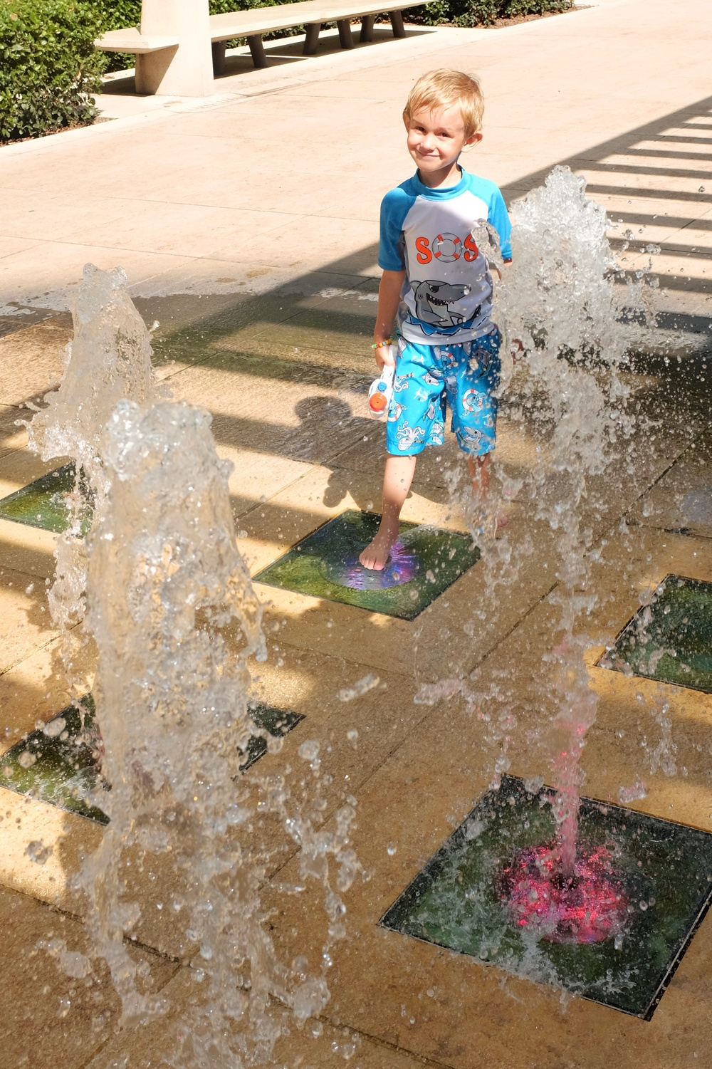 Kian enjoying the cool splash on the hot sunny day