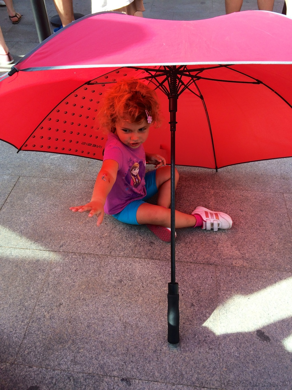 Hannah made a tent out of an umbrella to keep away from the hot sun
