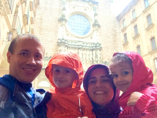 Drenched Family at Santa Maria de Montserrat Abbey