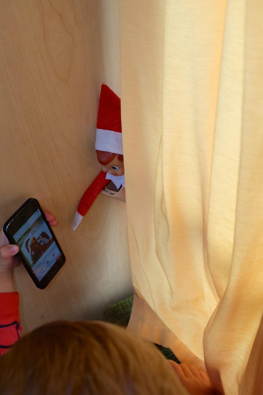 Kian sharing the ElmoSaves Christmas songs with Elmer.