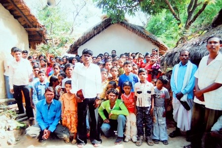 The church in Amda Village with evangelist Dhansai Bhotra, the young man in the white shirt in the middle