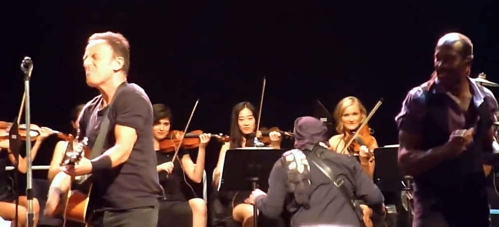 Airlie Koo's Australian Urban Orchestra performing with Bruce Springsteen