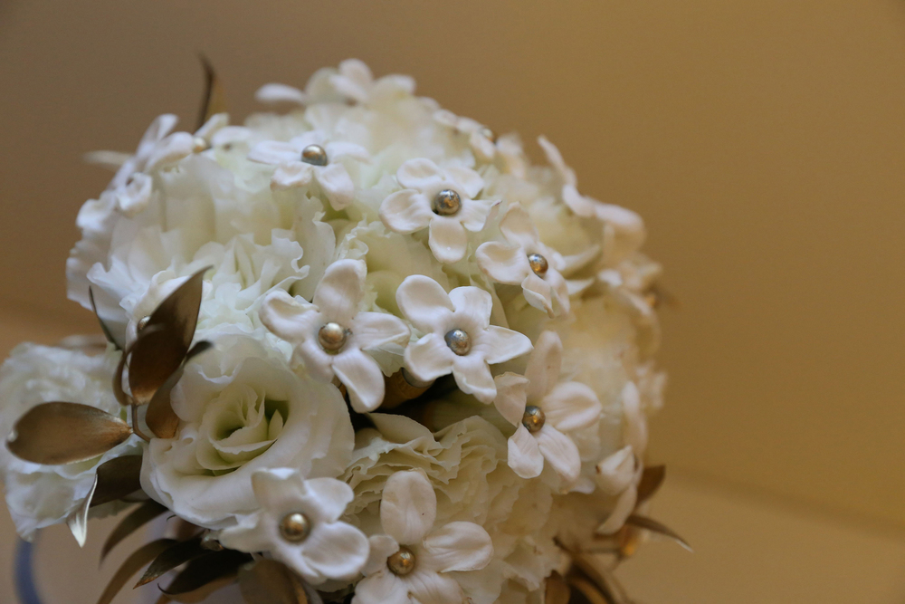 Winter Promise:  Beautiful stephanotis wired with a gold ball.  Simply elegant.