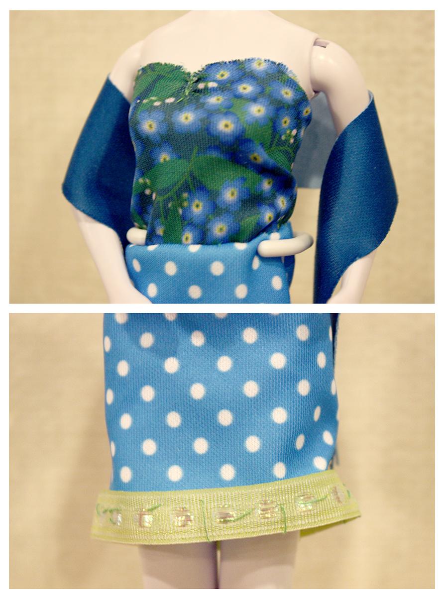 Let zeker op de details in de outfit — de stola over de armen, een gefronst topje en de zoom van de rok afgewerkt met een frisgroen lintje.