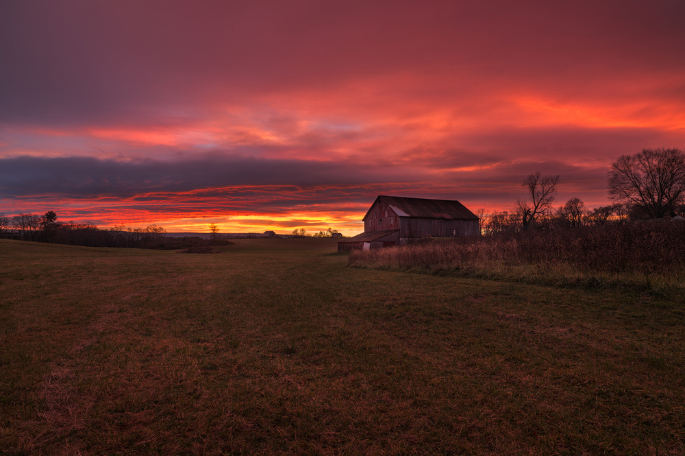 The Sky Explodes in the Colors of Sunrise over The Red Barn.