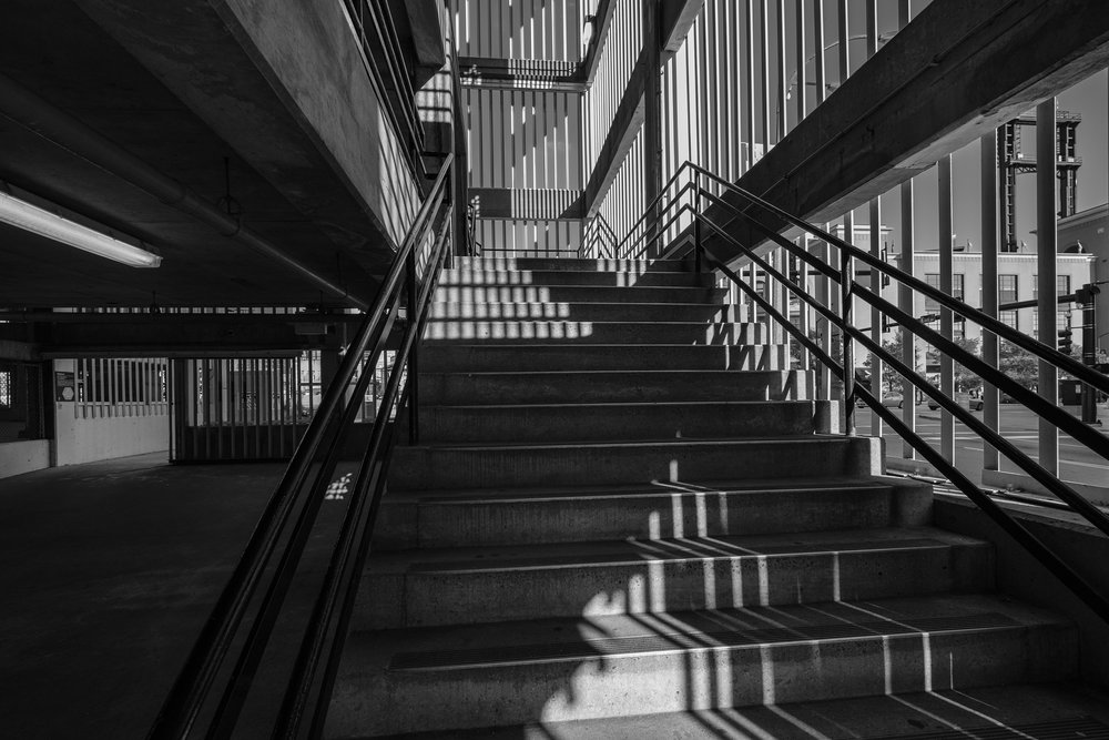 Crossing shadows climb a concrete stairway. Fuji X-Pro 2 and a Fujinon 10-24mm f3.5.