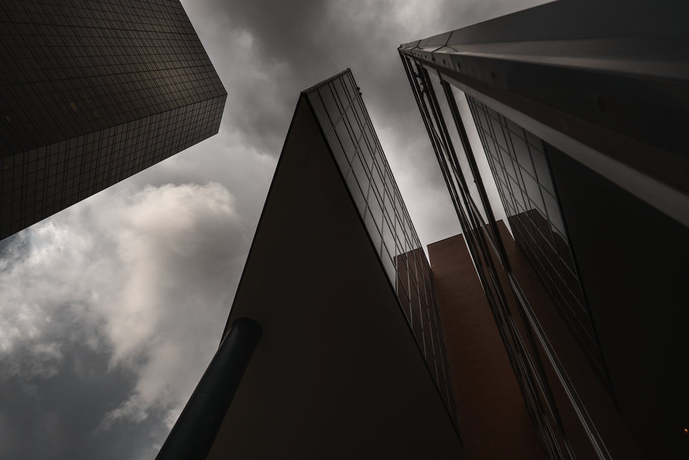 Clouds drift over a wedge of buildings. Fuji X-Pro 2 and a Fujinon 10-24mm f3.5.