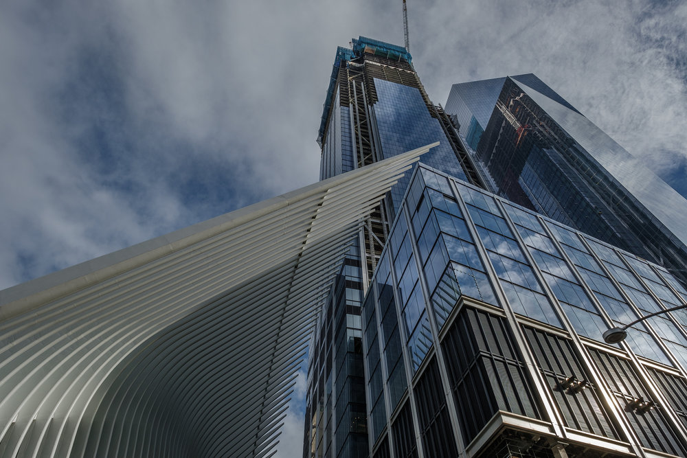 The fins of the Oculus seem to engage one of the new glass towers at the World Trade Center Site.