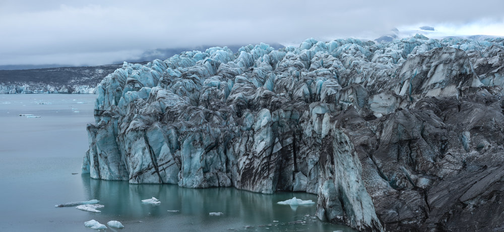 The ice calving site at Breiðamerkurjökull features huge seracs of blue-green ice.