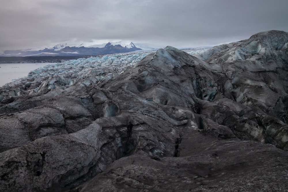 Ridges, peaks, and valleys of black ice punctuated with blue.