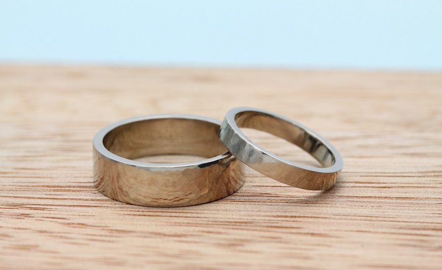 Hand fabricated 14k palladium white gold bands by Kristina and Ryan