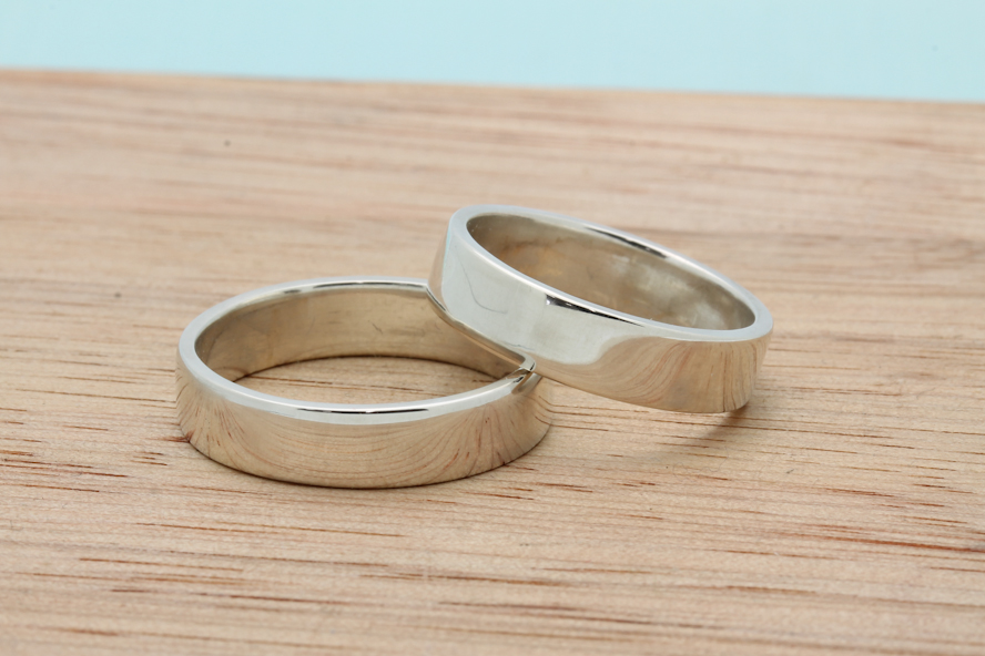Flat palladium sterling silver bands by Amanda and Declan with a polished finish