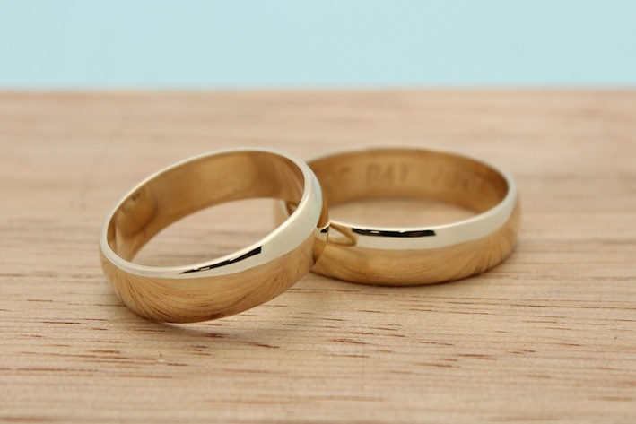 Hand fabricated, 14k yellow gold bands by Kim and Leif with a polished finish.