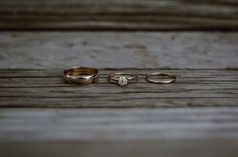 Rings by Keileigh & Ponny: 14k yellow gold, 5mm and 1.5mm polished half round bands with her antique engagment ring. Photos by: Catalina Jean