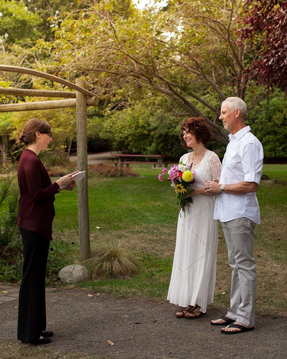 """Mark and Amy said """"I do"""" when Stephanie married them at Chetzamoka Park in Port Townsend after they picked flowers at Wilderbee Farm and made their wedding rings in a private session at With These Rings!  Photo Credit: MJ Photography"""