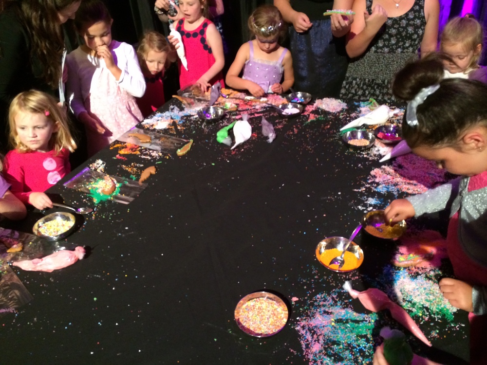 KIDS HAVING FUN DECORATING WITH SPRINKLES AT PREMIER OF FROZEN @ THE LANGHAM HOTEL-AUCKLAND