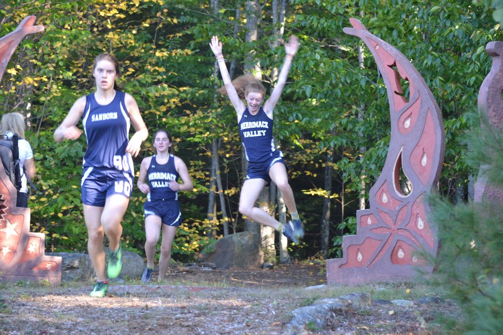 Don't we all feel this way about cross country? Kristie, jumping for joy, and Lauren readying her kick.