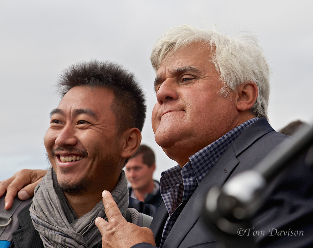 Jay Leno was surrounded by a crowd and the press, but I was able to be there in time to get a decent spot. He was in the middle of negotiating to buy one of the show motorcycles, but he appeared to by quite generous with his fans!