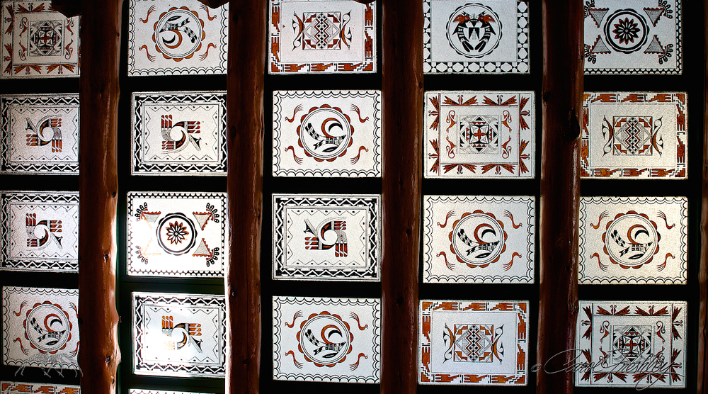 "The woman at the desk said, ""The best way to shoot that skylight is to go down 5 steps, position your camera on the fourth step, contort yourself beyond recognition, pray you don't dump your camera in the process.  Shoot quickly!""  She was right.  These are patters of famous Navajo rug patterns.  No, I still have not managed to straighten my body back to normal shape so no laughter the next time you see me."