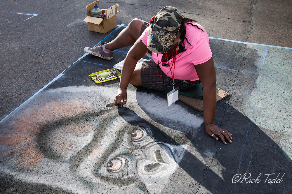 "When finished, this chalk art gorilla will be shown reading a book entitled, ""The Origin of Man""."