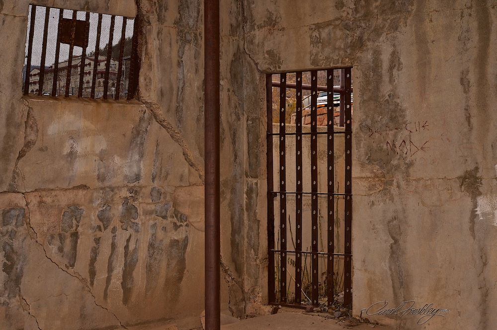 I have heard that this is the old jail and that it is sliding off the hill. Below is the real scoop.