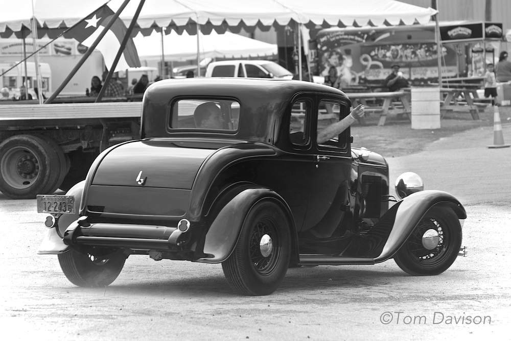 If you guessed that this is a 1932 Ford you are correct.  It is a 5 window model coupe.  Did you guess that?  In this car, the owner chose to retain the fenders.