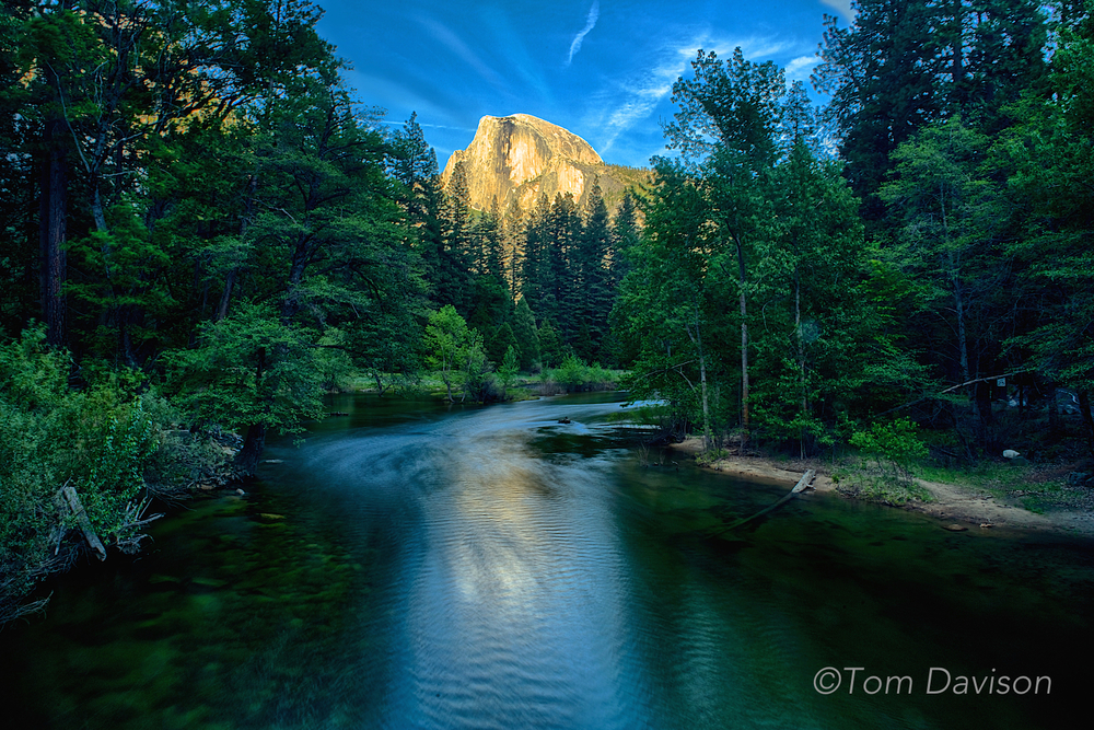 This is an image of Half Dome taken from Sentinal Bridge. This is the most common spot for taking shots of Half Dome. We were told to check out the spot along the river from Parking Lot A. We liked it better. Either place collects photographers at sunset and it is a good idea to stake out your place early. Half Dome stays lit long after the foreground goes dark. It is not gold every night as we see in photos taken by others. It can be a dull gray with only a yellow tinge.