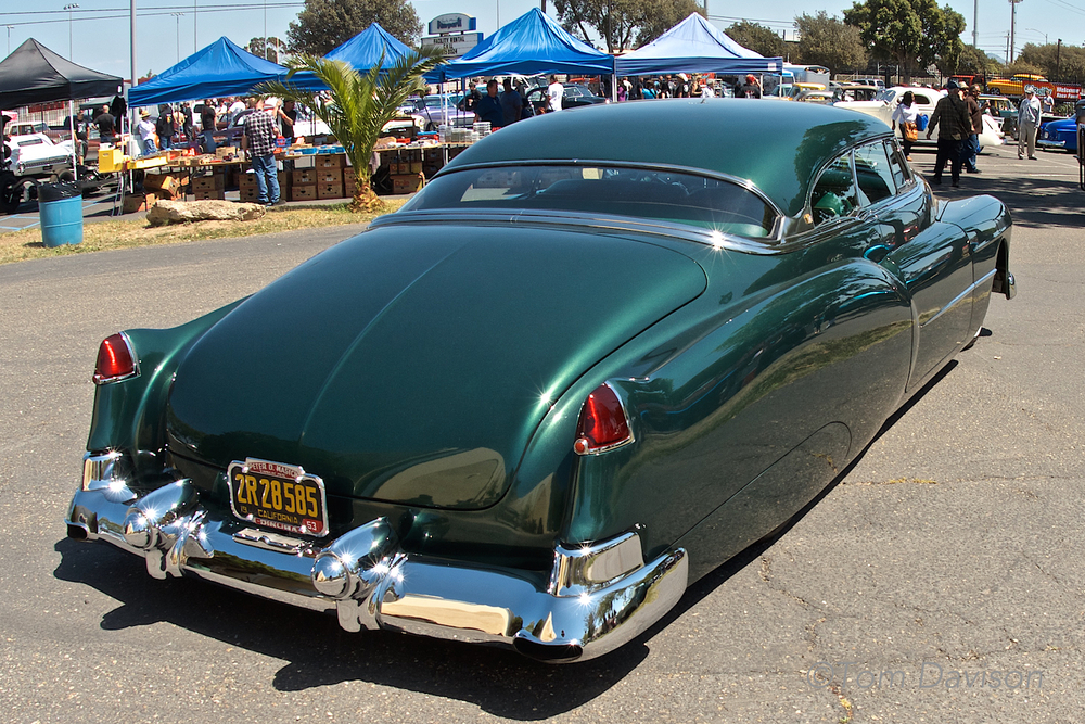 "This is a 1953 Cadillac done in a classic leadsled style. So, I ask Tom, ""What does leadsled mean?""  It refers to the choice of body filler.  In the past they used melted lead.  Now they use 'Bondo' body filler.  Just guessing it is easier with Bondo."