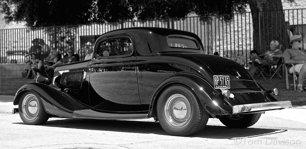 A 1934 Ford 3 window coupe.