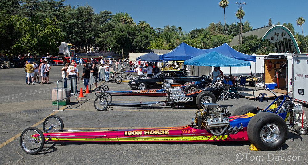 These are 1960s vintage super charged fuel dragsters, generally created as a copy of famous drag cars of that era.  The attraction is that they start these up and they are the most powerful engines ever built for racing.  They are capable of running a quarter mile in 4.5 seconds while attaining a top speed of 250 mph.