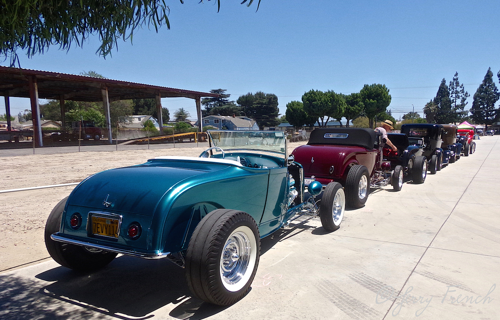 Row of hot rods parked at the SoCal Speed Shop Open House held before the show.