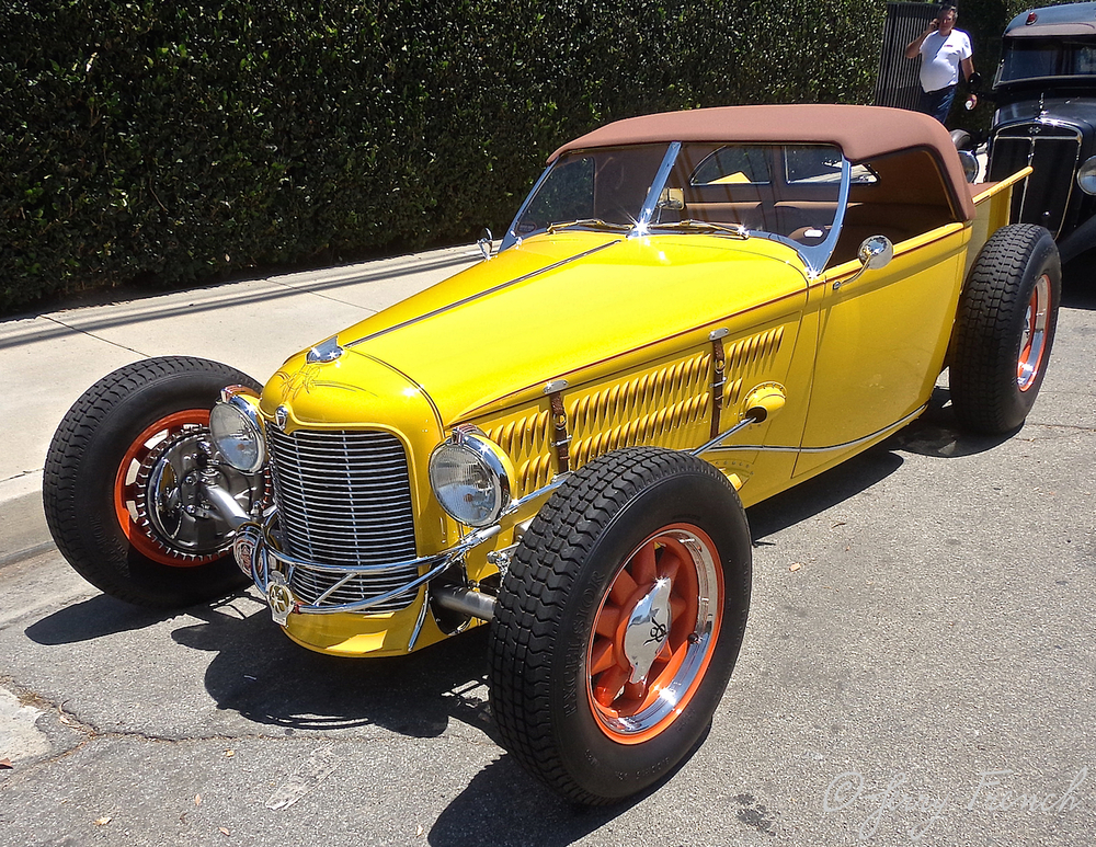 A handmade roadster using parts from old Chryslers.  I swear this car is grinning at me!