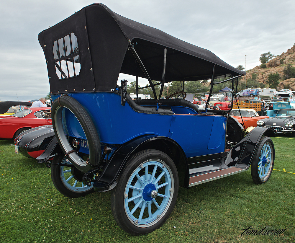 "1913 Rio Touring Car. Tom learned that the car had been in the same family since 1956 and had undergone a complete concours-quality restoration. Tom told the owner that Jerry's Dad had worked for Rio in Jerry's birthplace of Lansing, MI. So, when Jerry came by later, after chatting with the owner for a while, he gave Jerry the last one of his custom made ""REO Lansing, MI"" t-shirts!"