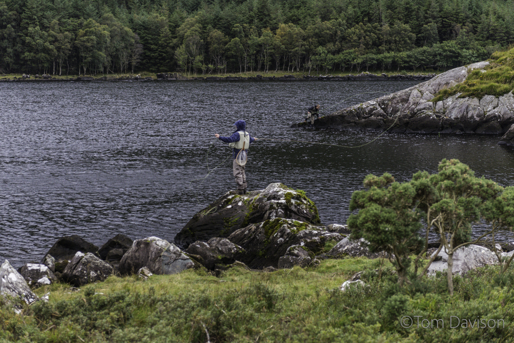 Look carefully, you can see the line. He is fly-fishing and catching.
