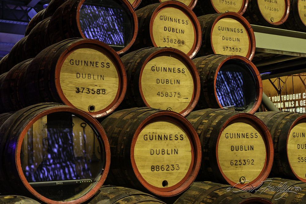 Guinness built this high entertainment information venue in what was once part of their fermentation plant.  Their goal was to educate the public about making brew and most especially about what makes Guinness so special.  The cost of admission include a free pint of the good stuff which you are welcome to have after you go through a short introduction on how to taste beer.  In this image, the blue blur is caused by a video being played demonstrating how oak barrels are made.  Very interesting!