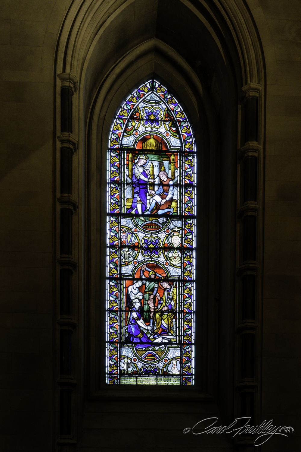 The stained glass windows were gorgeously detailed. Unfortunately, protective screens have been placed on the outside of each one and the mesh can be seen through the window.