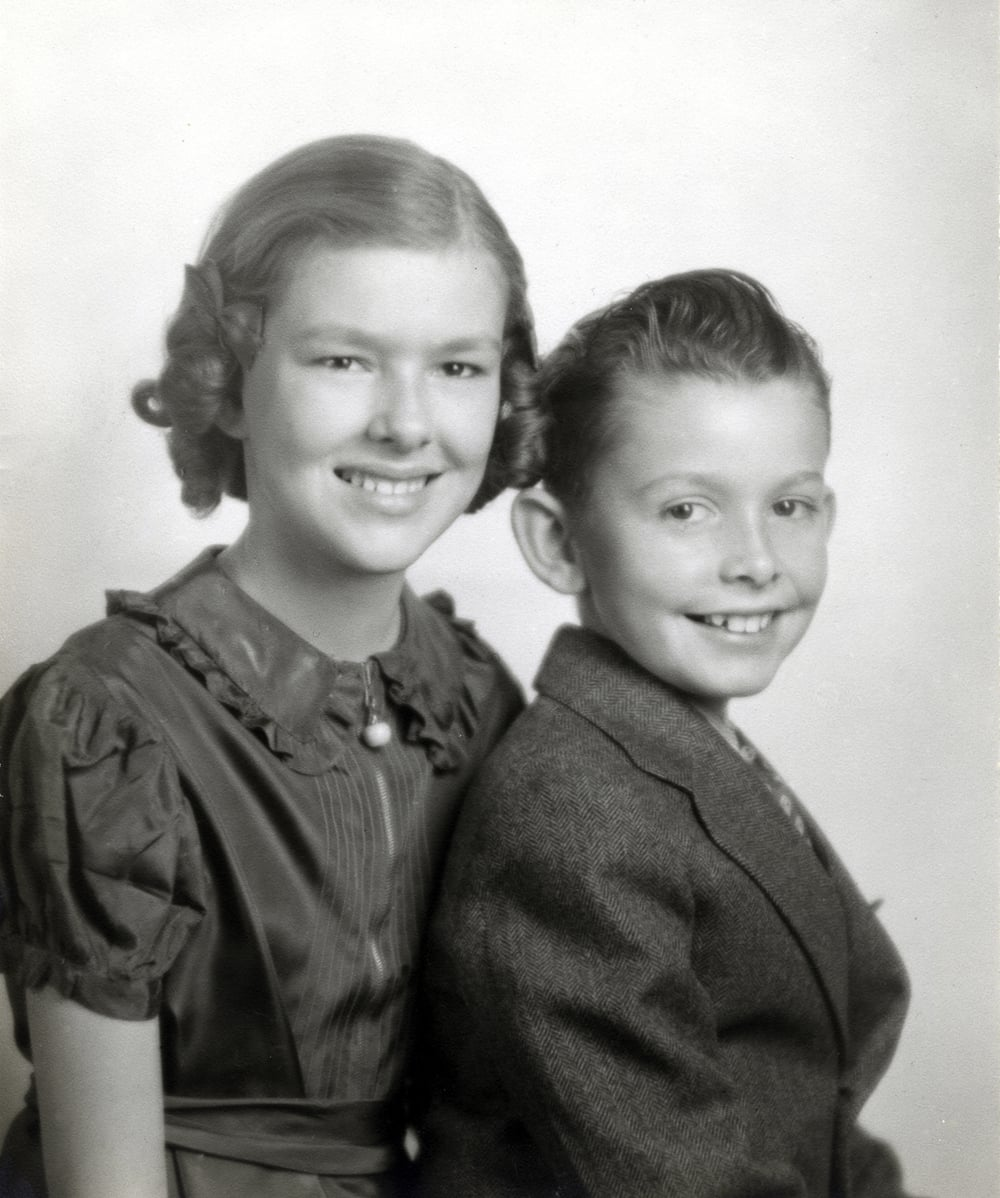 Shown here with her brother Joe. She was particularly fond of her younger brother, and shared his love of cars and racing. I believe this photo was taken when she was about 11.  Joe died in his early 30s while our family was living in Buga, Colombia.  Mom could not make it back for his funeral and I remember her crying for several days, feeling, I am sure, so very far away from the brother she had loved.
