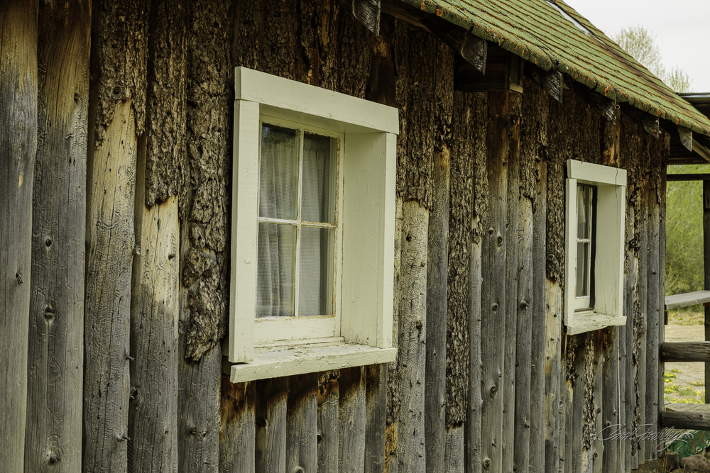 Numerous properties along the road are for sale.  How about a 10 cabin fixer upper?