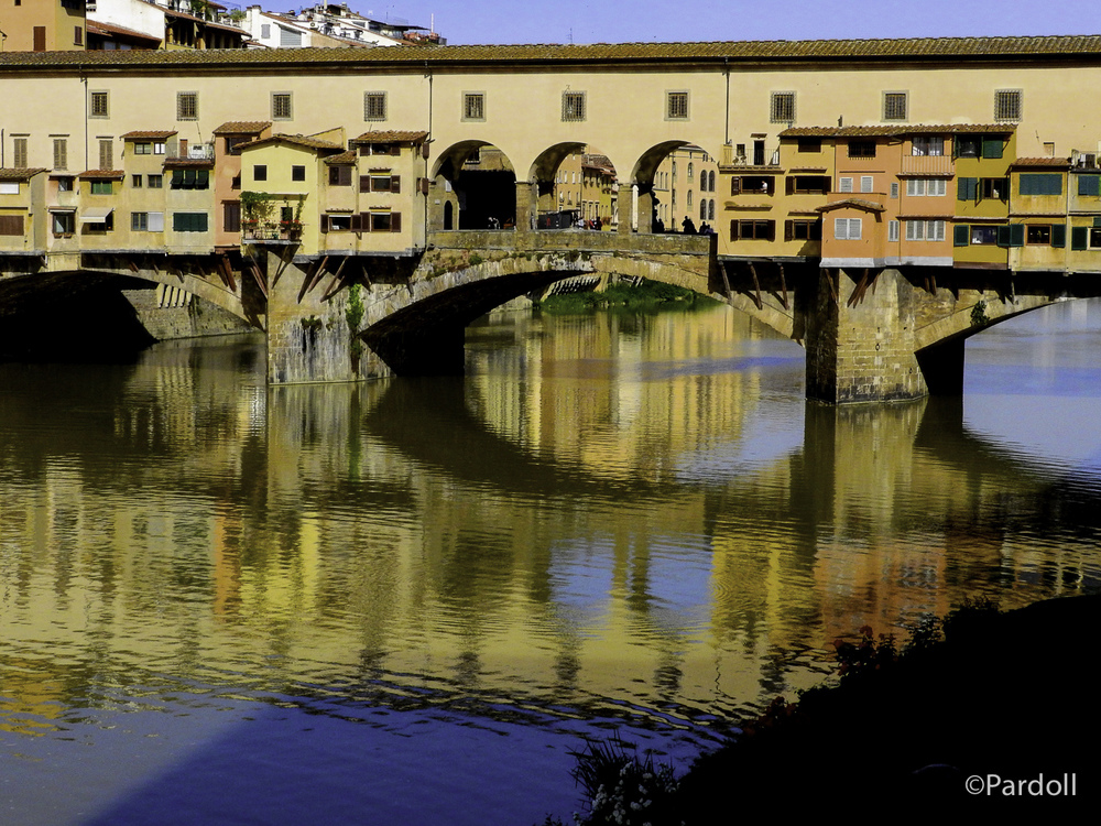 Ponte Vecchio over the Arno River.  The rent for these shops must be pretty high to be located in such a wonderful setting.