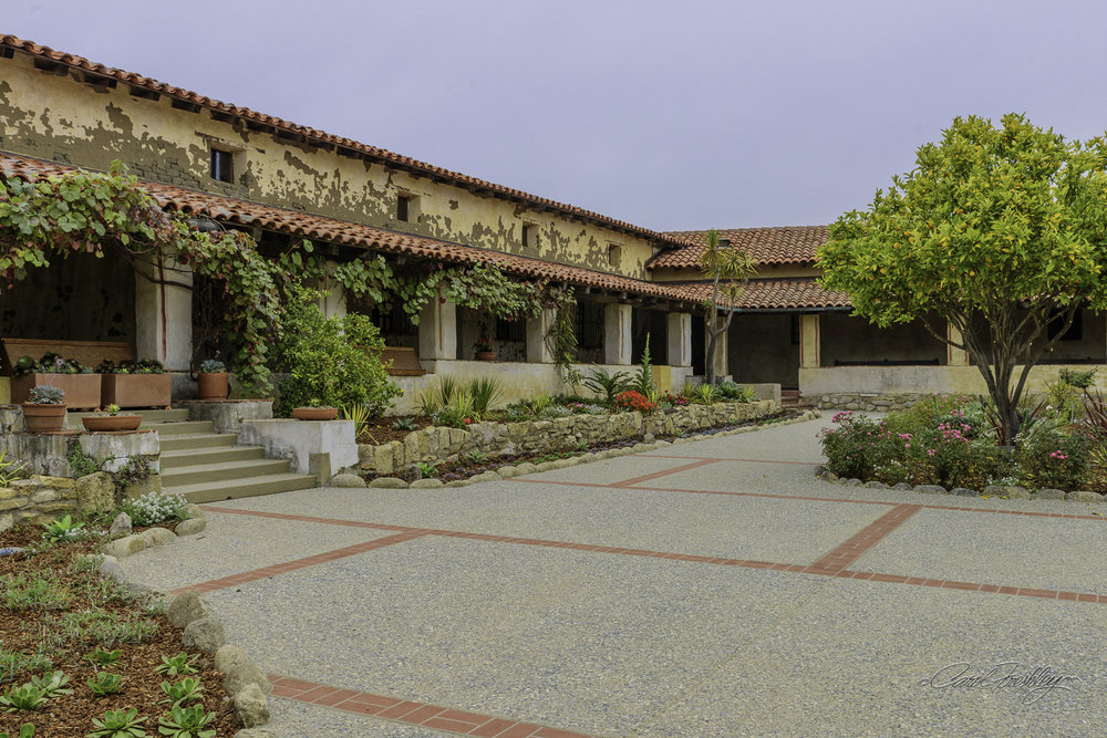 Just a part of a large courtyard with many flower beds.  The rooms in the back were used for lodging.