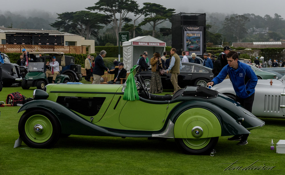 The presence of a green ribbon such as this indicates that the car completed the Tour d' Elegance.  This is a 40s vintage BMW sports roadster.