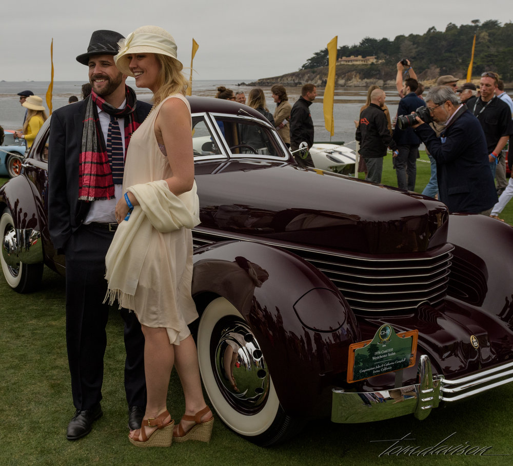 The car is a 1937 Cord.  The pretty lady . . . not from 1937!