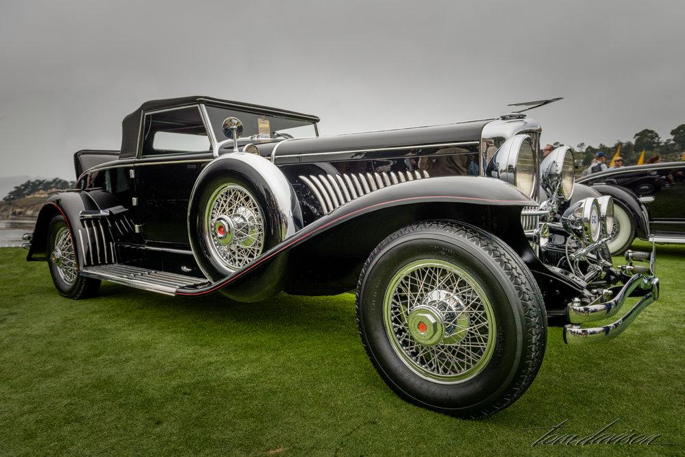 A Deusenberg roadster (probably 1932).