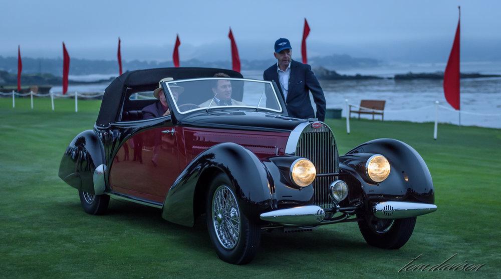 An arriving Bugatti.