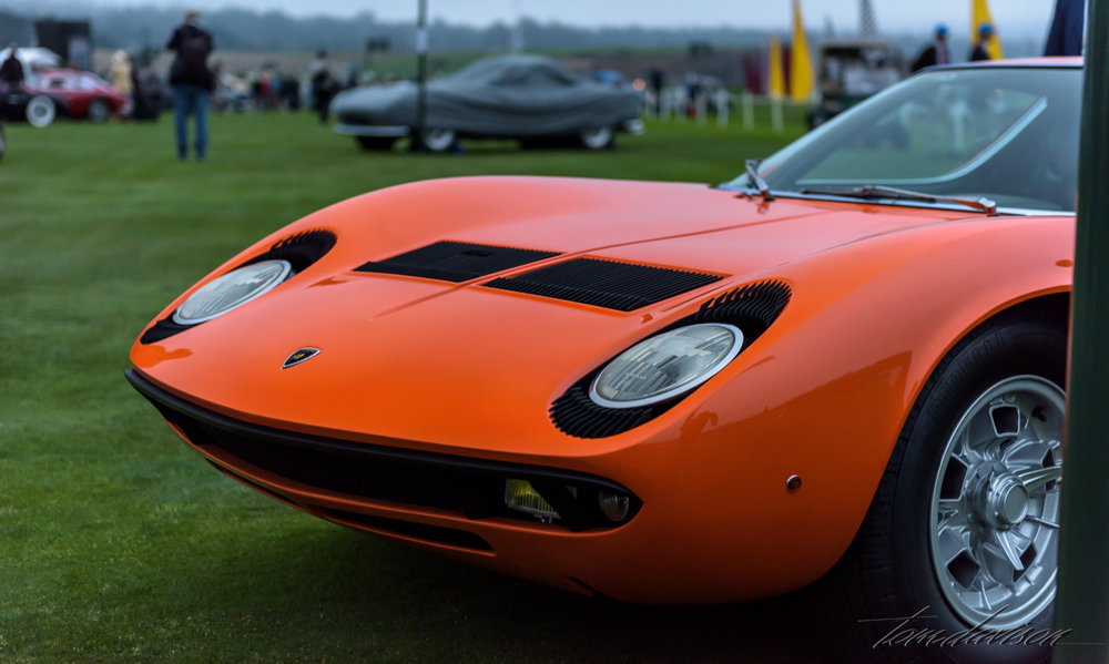 Front detail of a Lamborghini Miura.  This model is considered the first supercar in the sports car world and the most beautiful by many design experts.