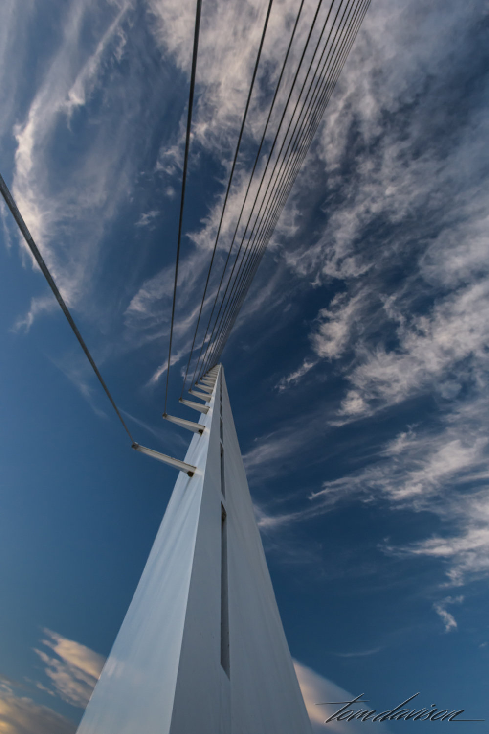 The tall pylon is 217 feet high and supports 4,300 feet of cable.