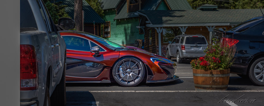 Before our trip back home we stopped to rest for a few minutes in a parking lot.  Tom spotted this car, a McLaren P1.  Perfect complement to the emerald green and deep blue of Lake Tahoe.