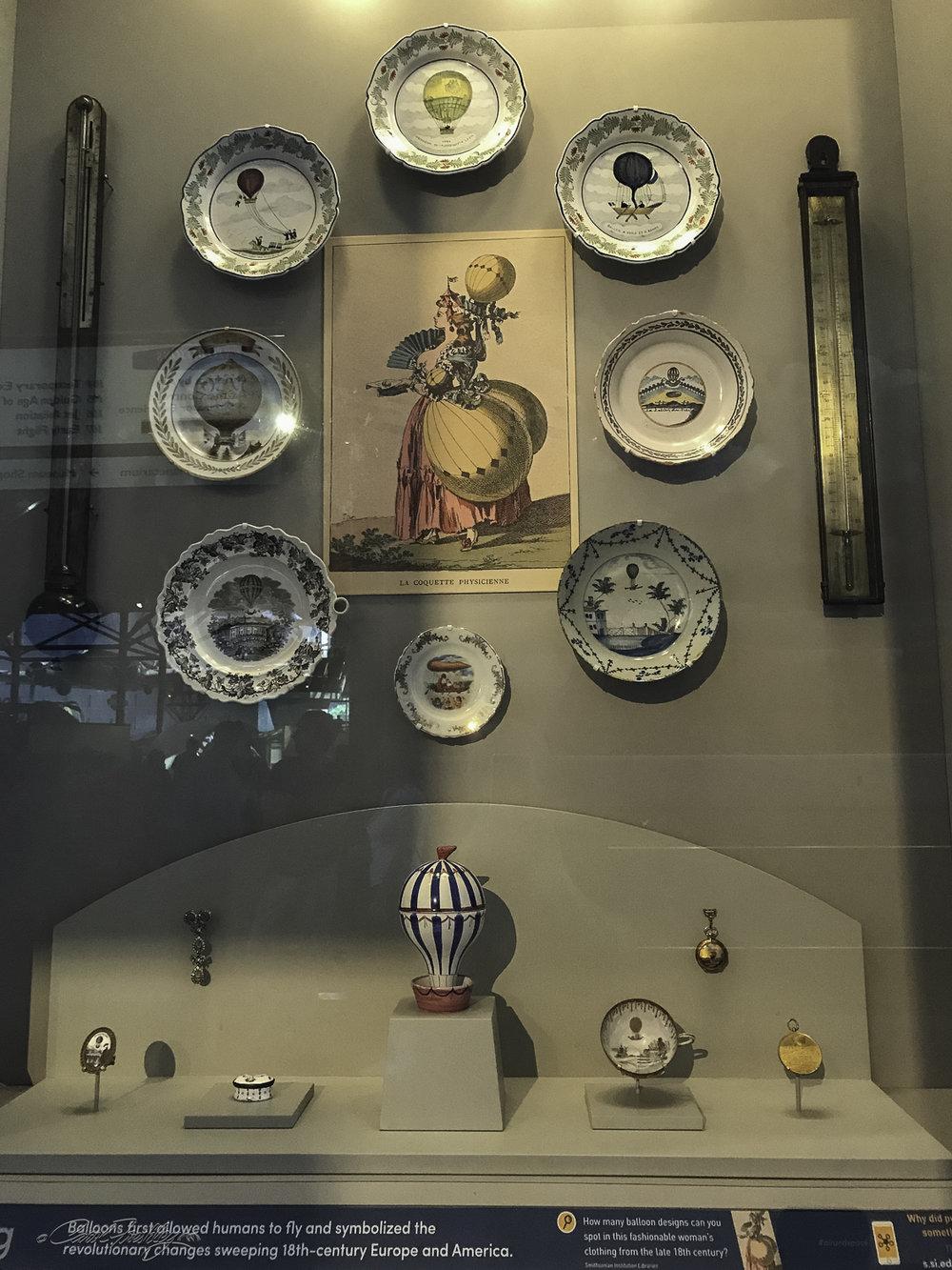 According to the sign next to this display, balloon-inspired hair and clothing were all the rage in the final years of the 18th century. Artisans created jewelry, hats, needle cases, snuff boxes, wall hangings, clocks, furniture and much more to attract they eye and empty the pocketbook of customers.