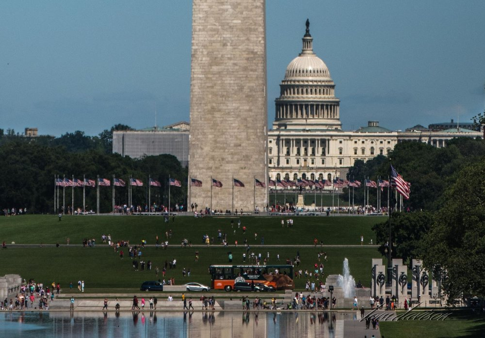 A compressed image taken from Lincoln's Memorial across the mall, putting the Washington Memorial in front of the Capitol.