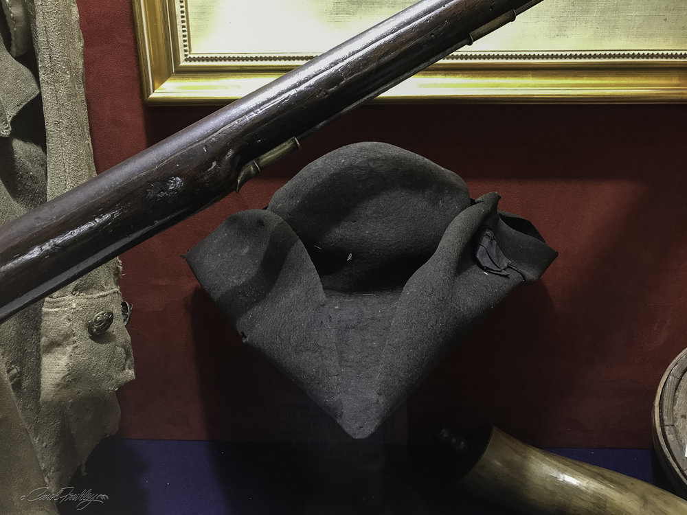 This is a tricorn hat, a civilian hat pattern popular in the 1750s and 60s.  This style hat was still worn by many American Militiamen during the American Revolution.